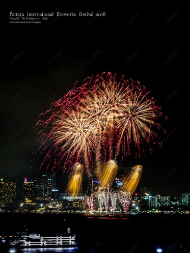 Fireworks over cityscape by the beach and sea surrounding with hotels, restaurant, and service boats and cruises sign of cristmas/ New Year eve and special festival.